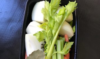 food storage box with aromatics and vegetables to make stock