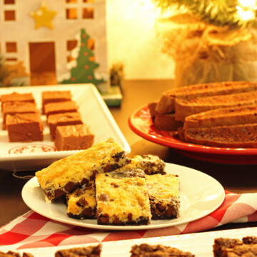 A bunch of different types of cookies on plates
