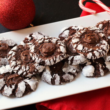 cookies on plate with candy cane and ornament