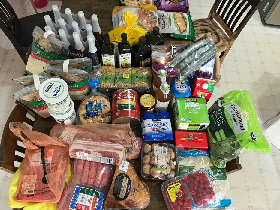 groceries from Costco laid on kitchen table