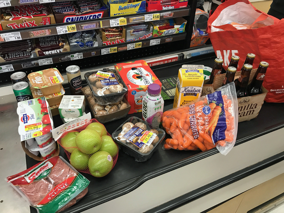 groceries on conveyor belt at grocery store