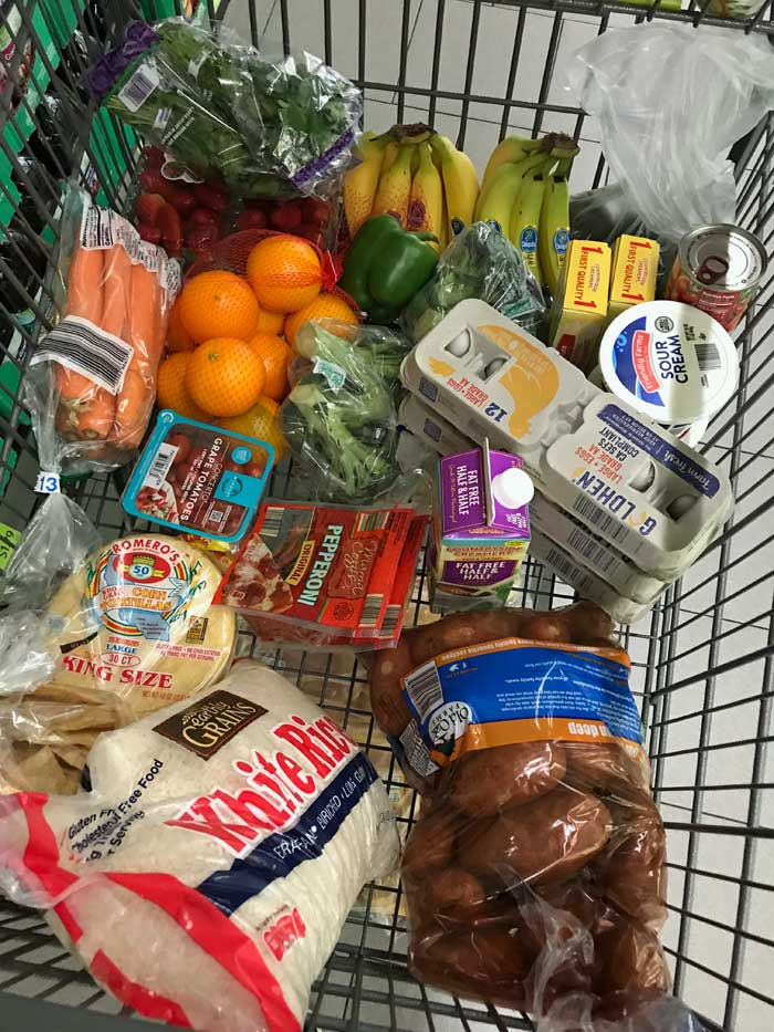 bags of rice and other groceries in cart