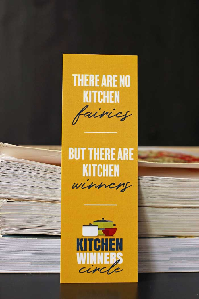 no kitchen fairies bookmark by stack of cookbooks