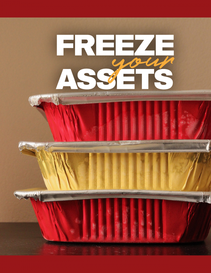 a stack of freezer meals in red and gold aluminum pans