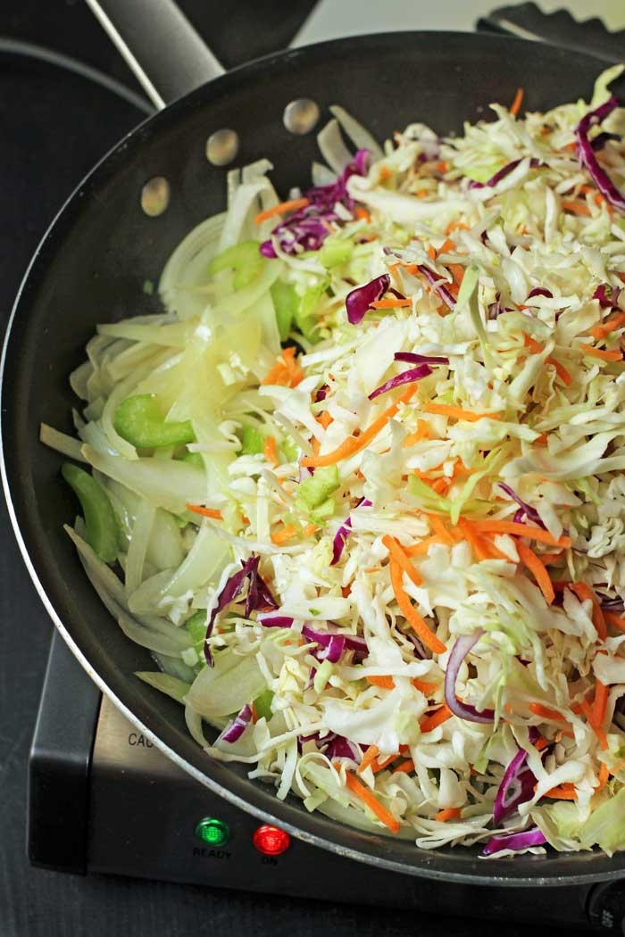 adding coleslaw to skillet