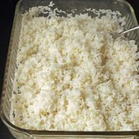 baked rice in baking dish with fork
