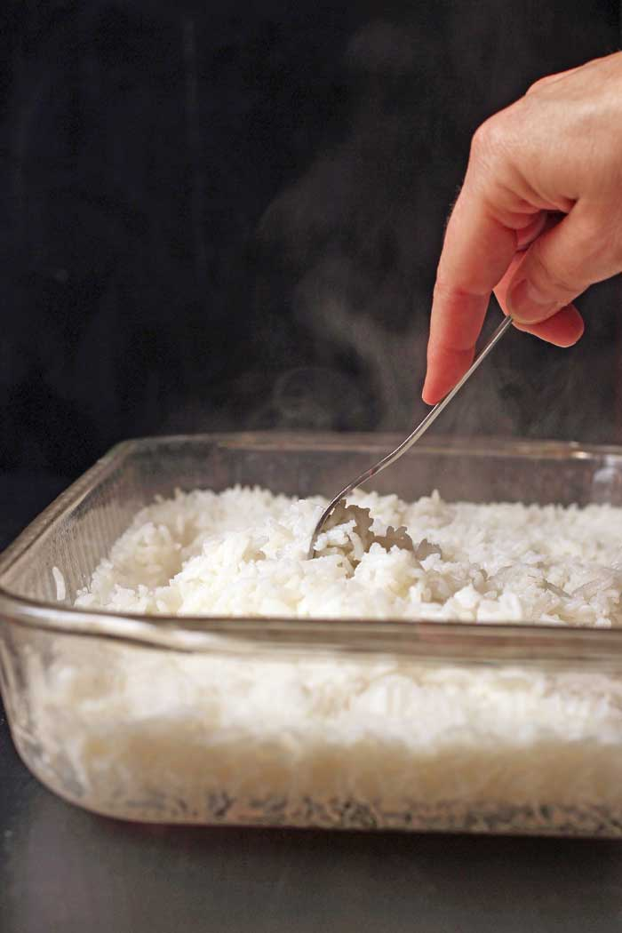 fluffing baked rice with fork