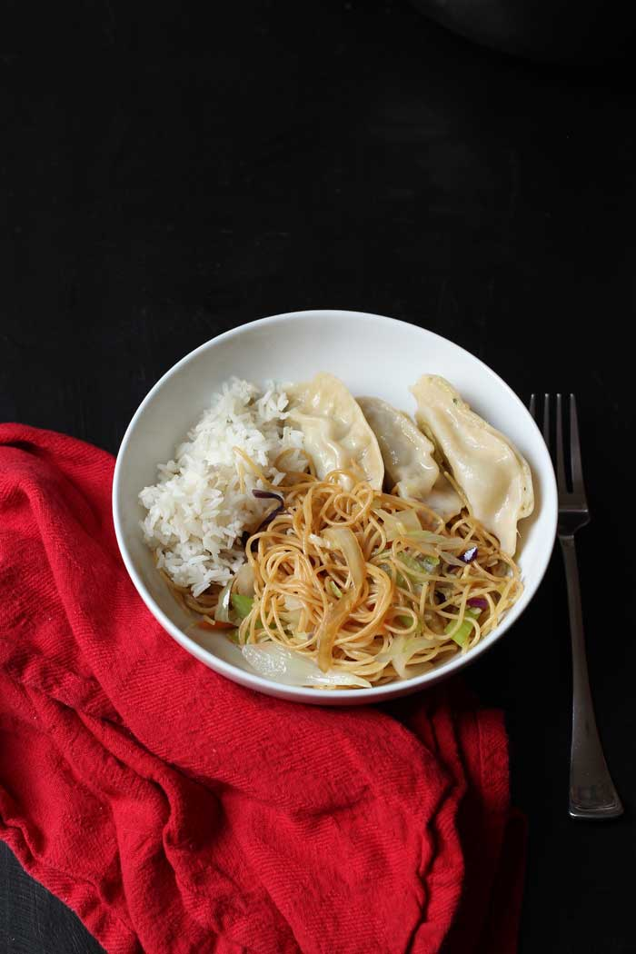 bowl of chow mein, rice, and potstickers