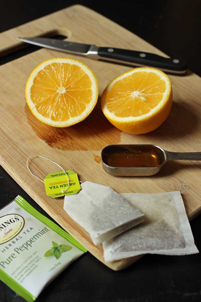 honey, tea, and lemon halves
