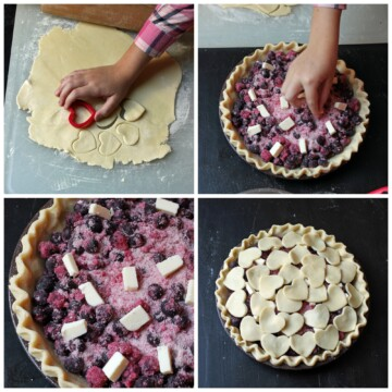 applying heart-shaped cut-outs to blueberry pie