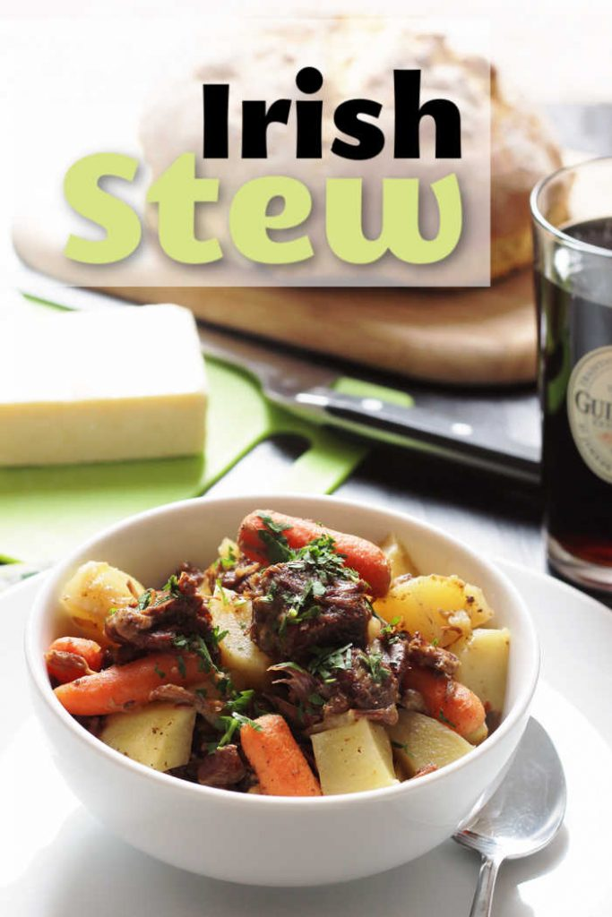 A bowl of Stew, with cheese and beer
