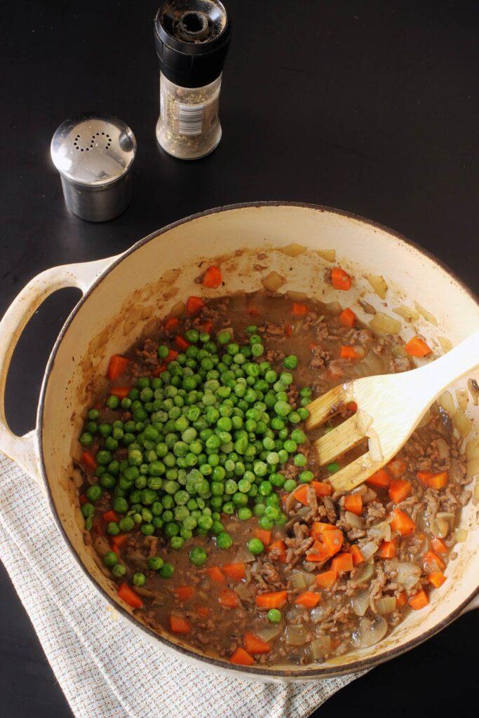 adding peas to pot