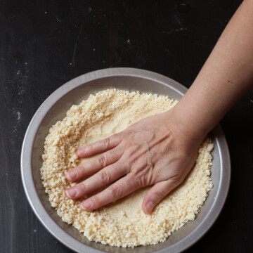 patting pie crust into pan