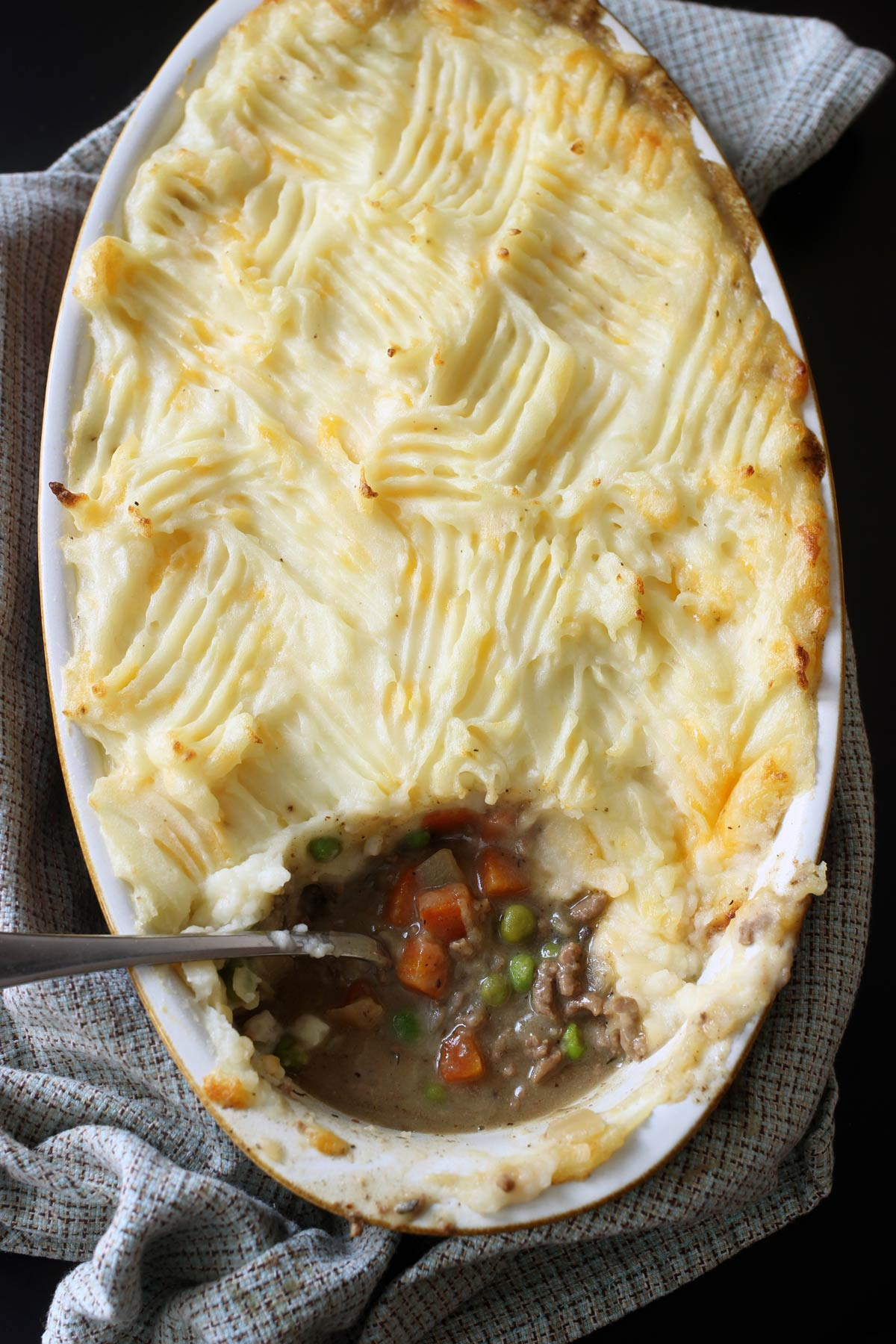 shepherd's pie with spoonful removed