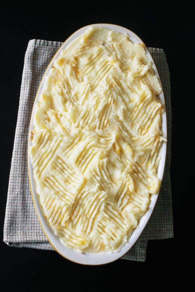 unbaked shepherd's pie with fork marks in topping