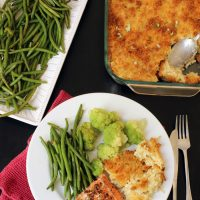 Cheesy Potatoes green beans and dinner plate with fish