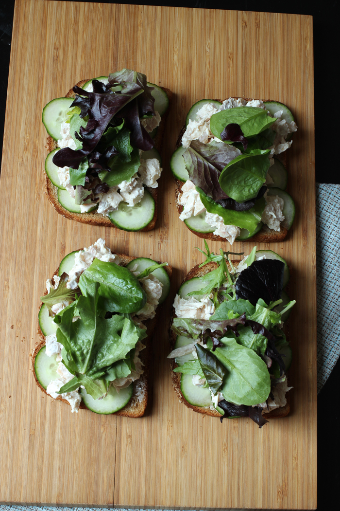 array of sandwiches with chicken salad and greens