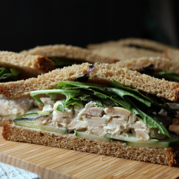 cut side view of chicken salad sandwich with cucumber