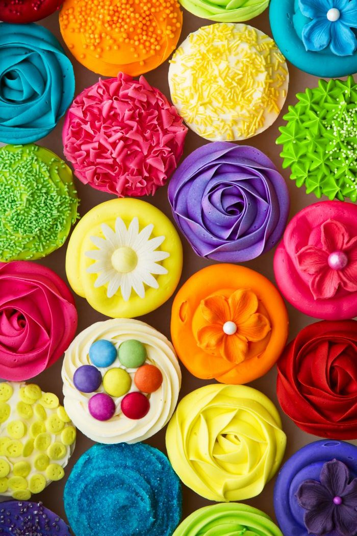 many different colored cupcakes