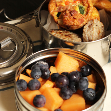 tiffin box with fruit and egg muffins