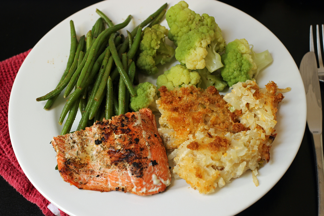 dinner plate with salmon beans cauliflower and potatoes