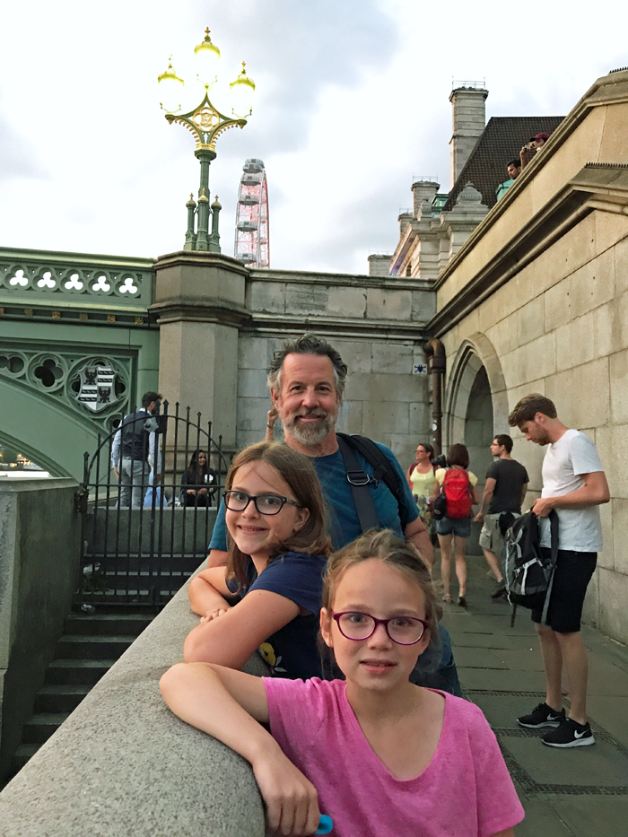 dad and girls on thames bridge