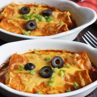 gratin dishes with cheese enchiladas