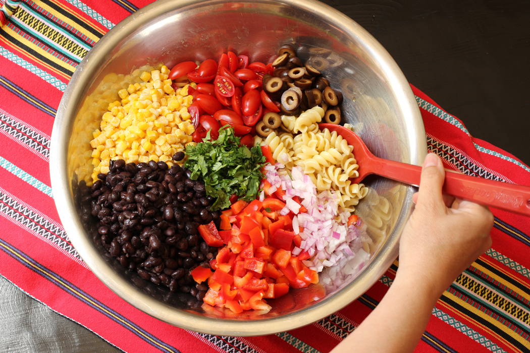 A bowl of pasta, black beans, and vegetables