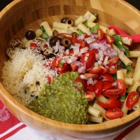 A bowl of pesto pasta salad ingredients