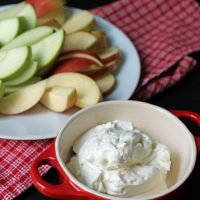 whipped cream in a dish with apple slices