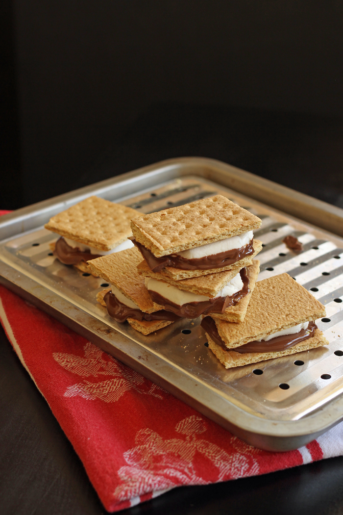 assembled smores stacked on broiler pan
