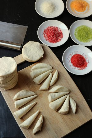 rolls cut into turkey feather shapes with dishes of sprinkles