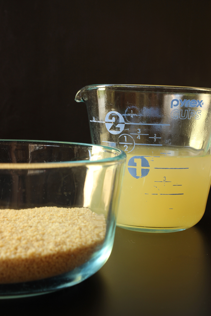measure of broth and bowl of couscous