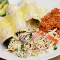 A plate of Poblano enchiladas with sides