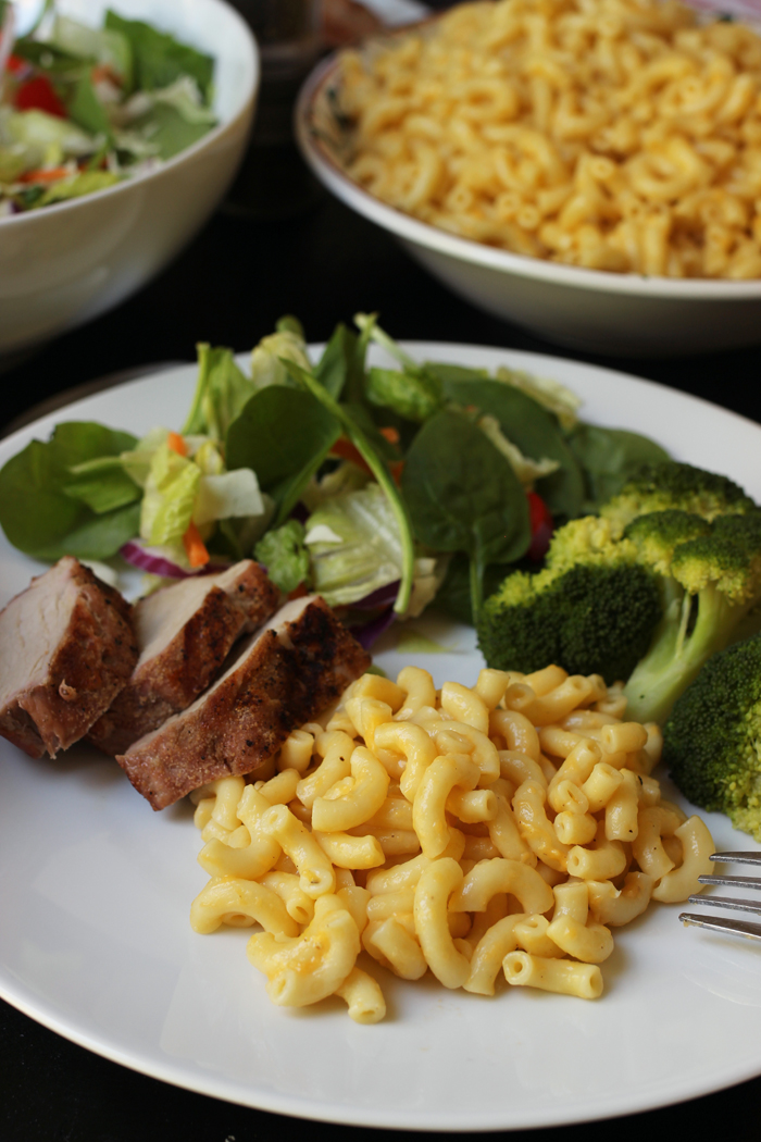plate of macaroni with pork and sides