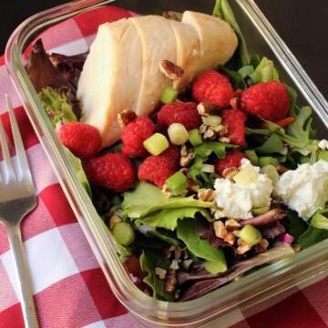 A tray of food on a table, with Raspberry Chicken Salad