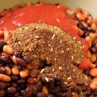 A bowl of beans and chili seasoning