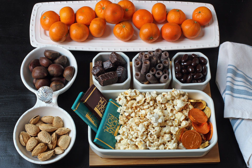 array of nuts oranges chocolate and popcorn