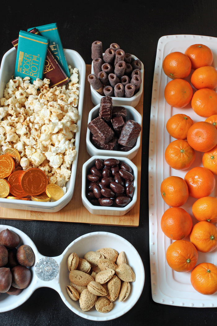 chocolate dessert board with fruit nuts and popcorn