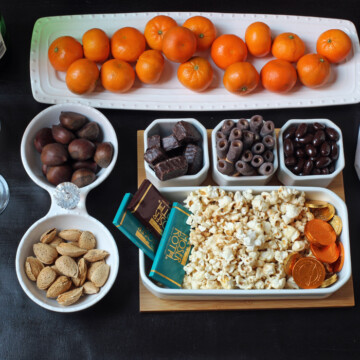 dessert table with fruit nuts chocolate and popcorn