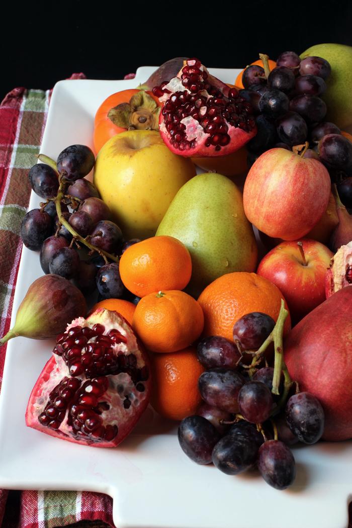 pile of winter fruit on a platter