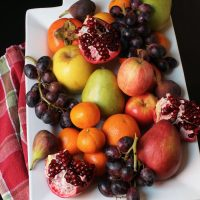 A plate of fruit sitting on a table