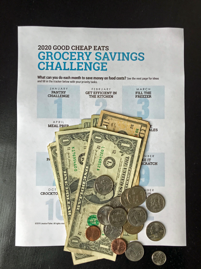 printed challenges worksheet with stack of money