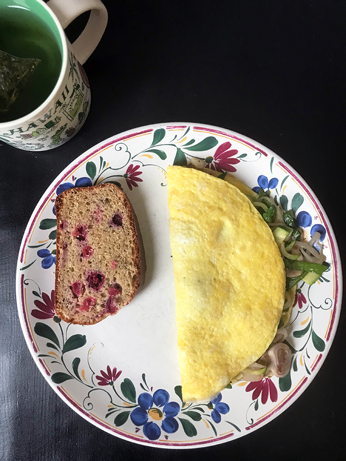 omelet on plate with cranberry bread