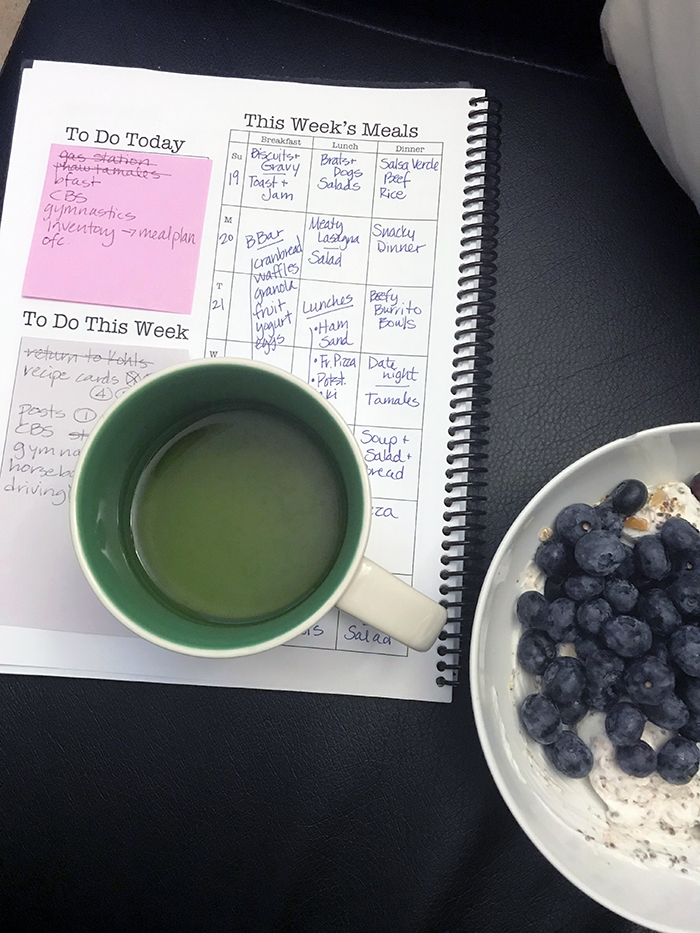 breakfast bowl with tea and planner