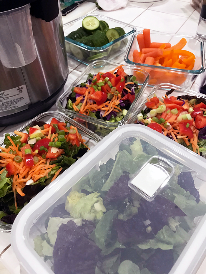 meal prep salads on kitchen counter