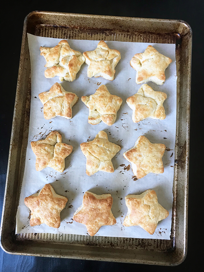 a dozen star biscuits baked on a tray