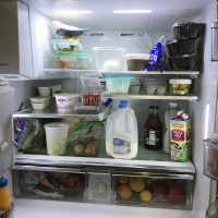 fridge showing empty space among groceries