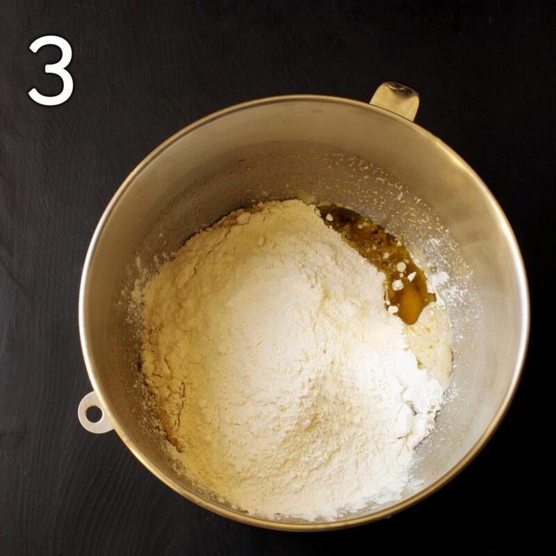 adding the flour and salt to the mixing bowl.