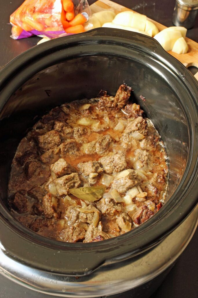 cooked meat in crock